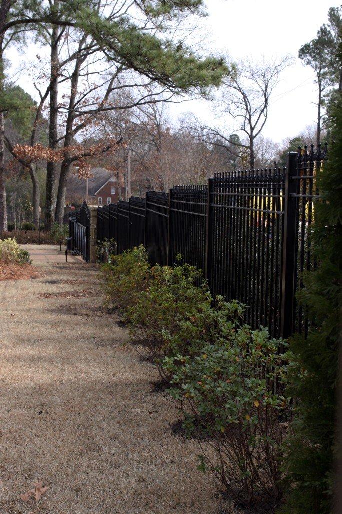 Iron Fence Stepped to Follow the Slope and Grade of a Yard
