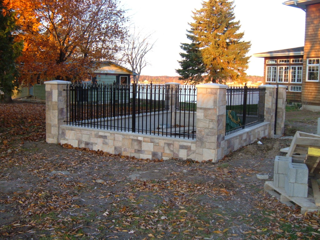 Our Iron Fence Used in Conjunction with a Stone Knee Wall and Columns to Make a Play Area for the Grandkids