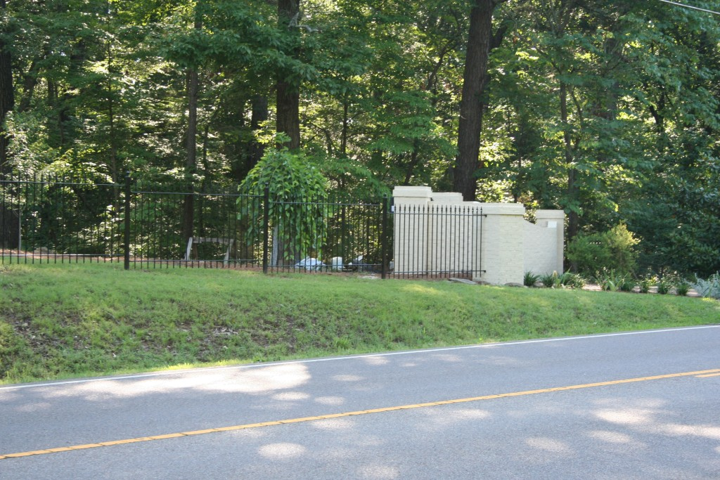 Iron Fence Stepped by Homeowner to Follow Grade