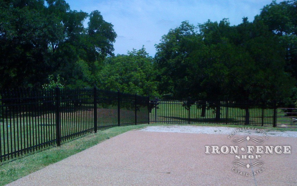 Aluminum Fence can 'rack' which angles the panels to follow yard grade