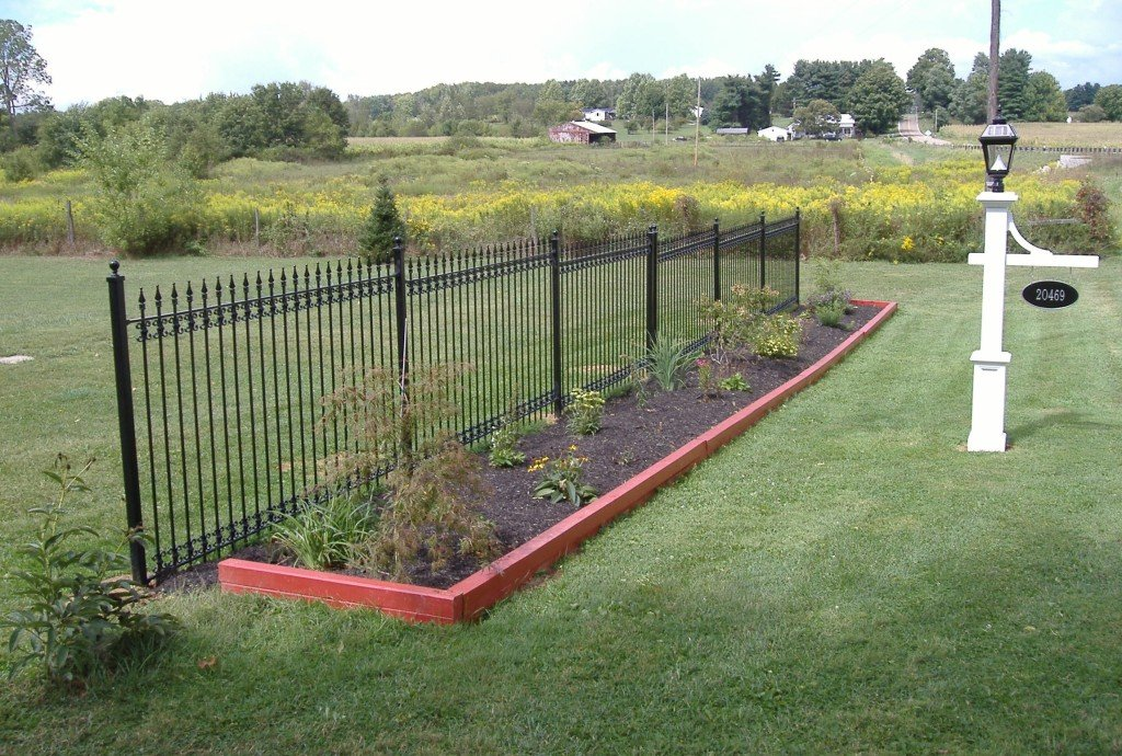 Iron Fence Used as Decorative Accent for a Garden