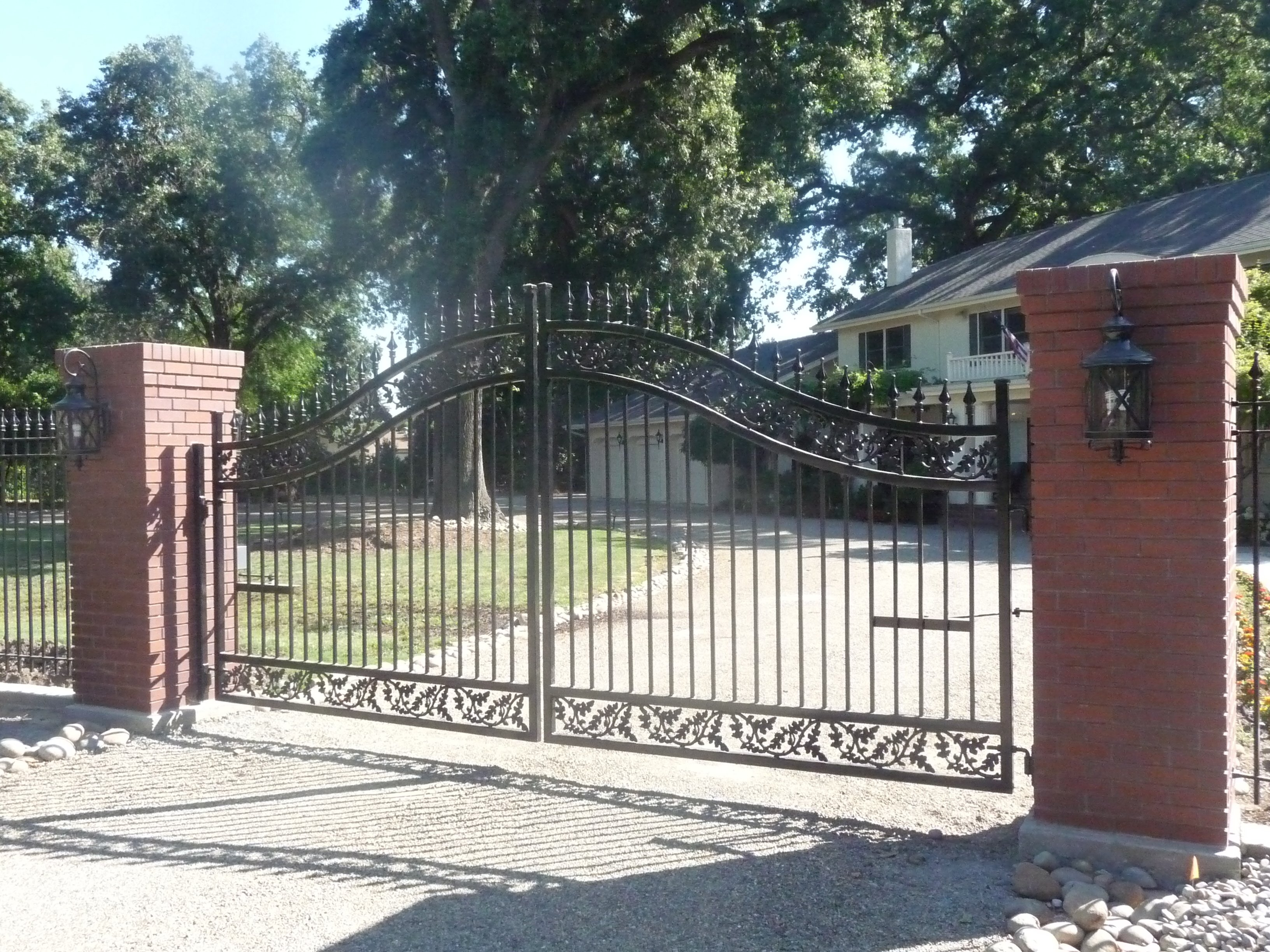 Examples of custom iron and aluminum fence gate