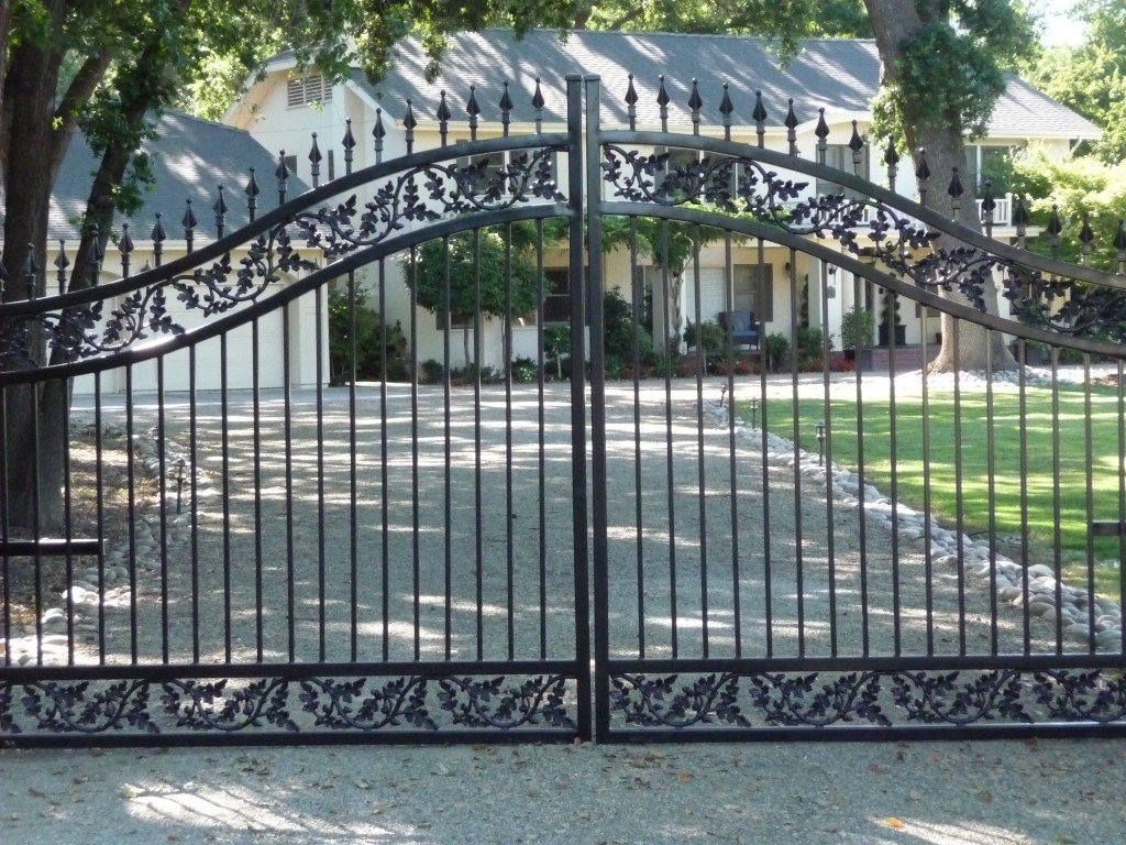 A Custom Iron Driveway Gate with Oak Branch Castings