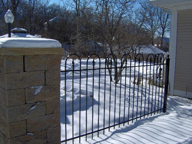 Iron Hoop and Picket Fence Installed while Snow was on the Ground
