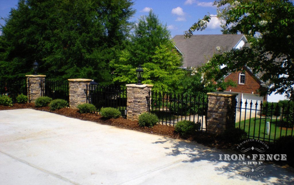 Iron Fence Mounted to Stone Columns