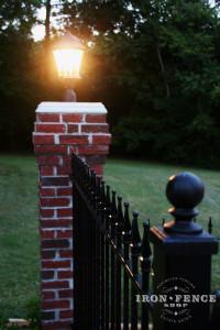 Iron Fence Mounted on Brick