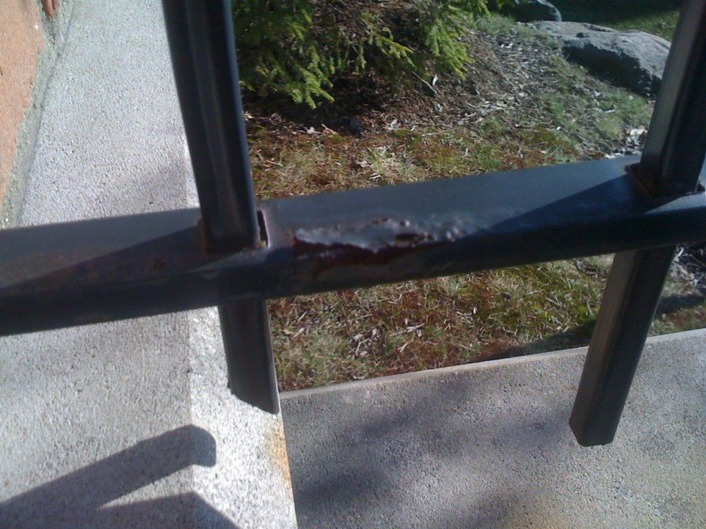 Example of Poorly Prepared Iron Fence Rail with the Finish Bubbling and Peeling