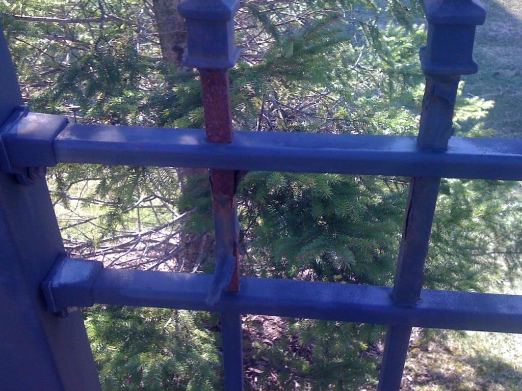 Peeling Finish on a Non-Galvanized Iron Fence