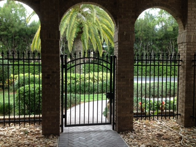 Arched Aluminum Gate in a Brick Entryway