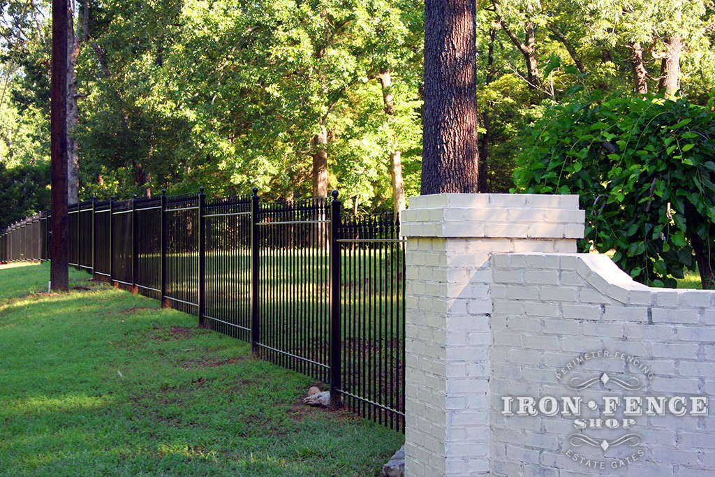 Iron fence panels can follow grade by 'stair-stepping', but it requires a little additional attention during planning and installation