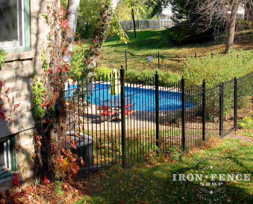 Iron Fence Installed on a Hill