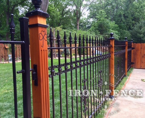 Using wood posts with wrought iron fence for a custom look