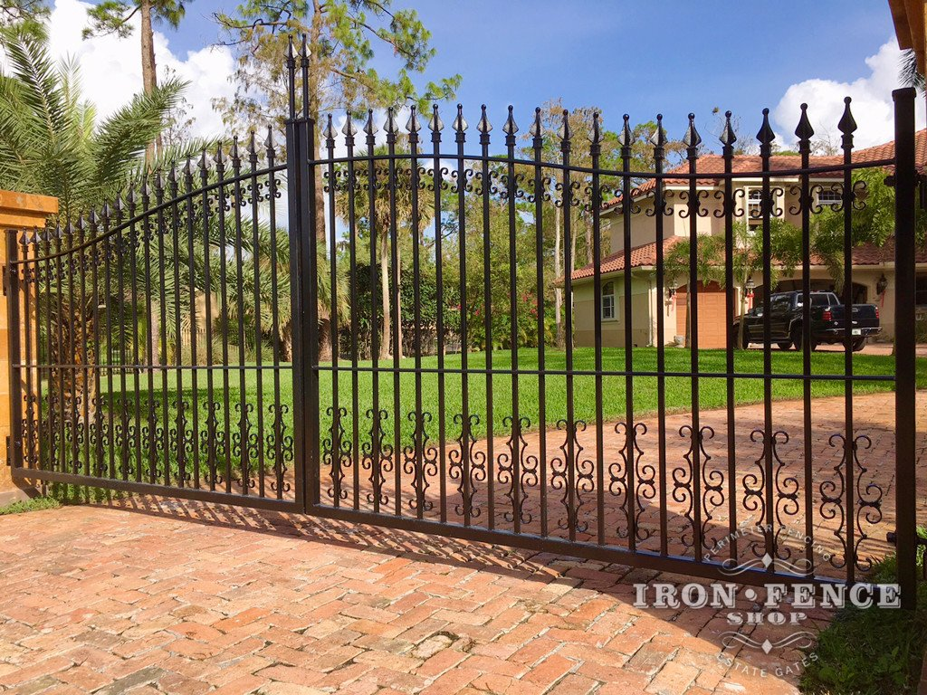 Iron Driveway Gate in Classic Style with Guardian and Butterfly Decorations Mounted to Columns