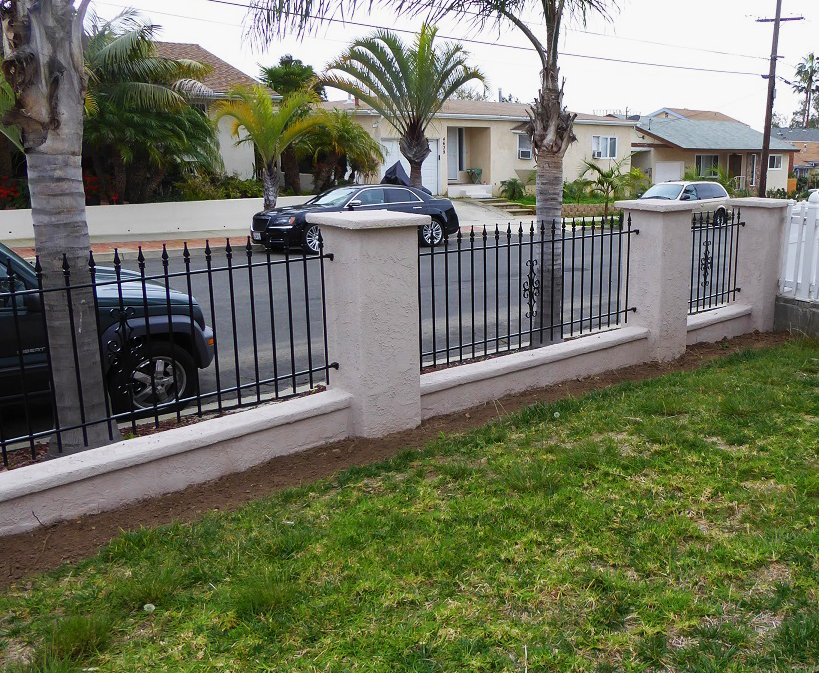 3ft Iron Fence Mounted on Wall Top Between Stucco Columns