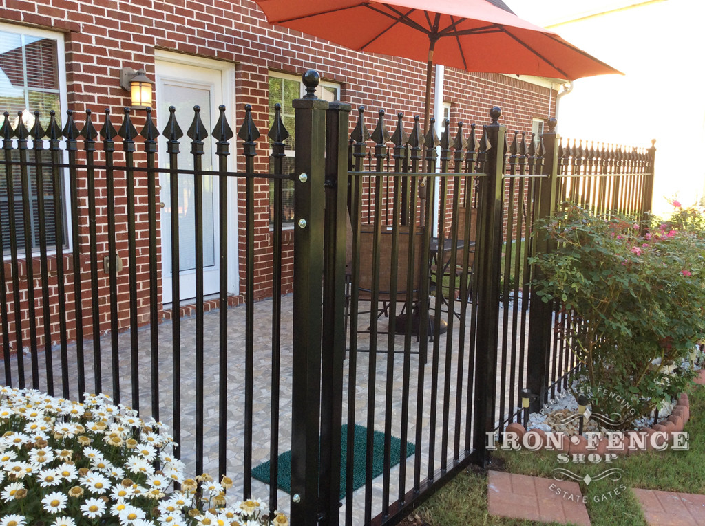 Wrought Iron Fence and Gate used to Enclose a Patio