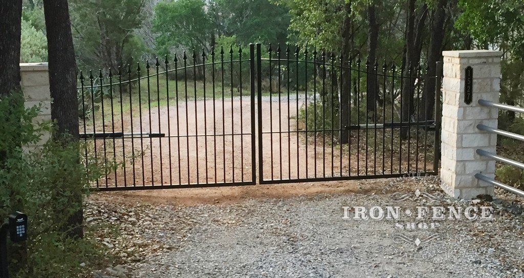 Wrought Iron Driveway Gate Mounted Behind Columns
