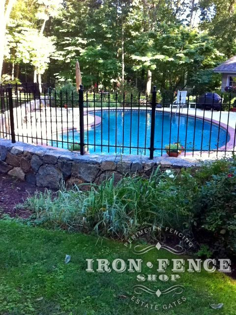 Iron Fence Angled Around a Curved Wall Top