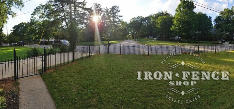 Panoramic shot of a front yard iron fence enclosure