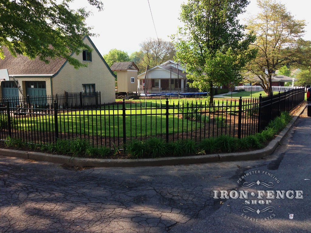 Aluminum Fence Installed Along a Curved Curb