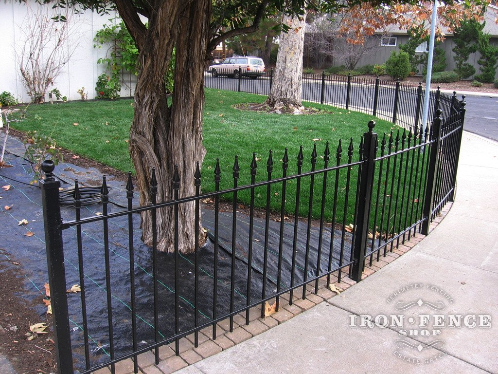 Iron Fence Panels Installed Along a Curved Sidewalk
