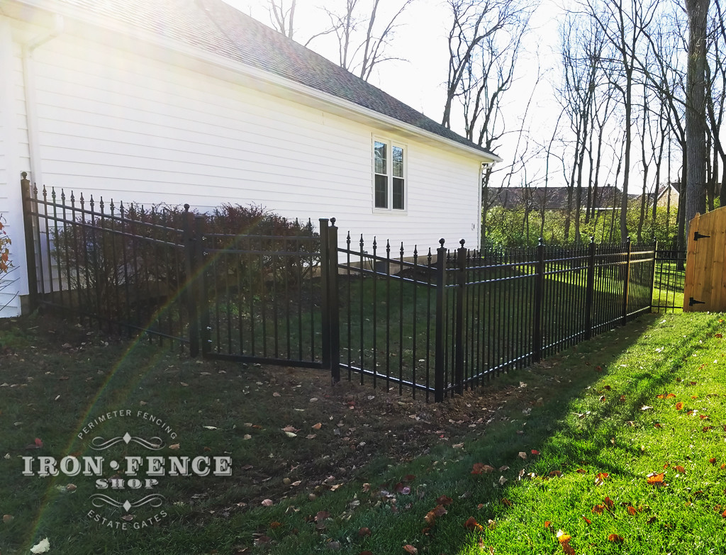 A Racked Infinity Aluminum Fence Panel and Stepped Gate