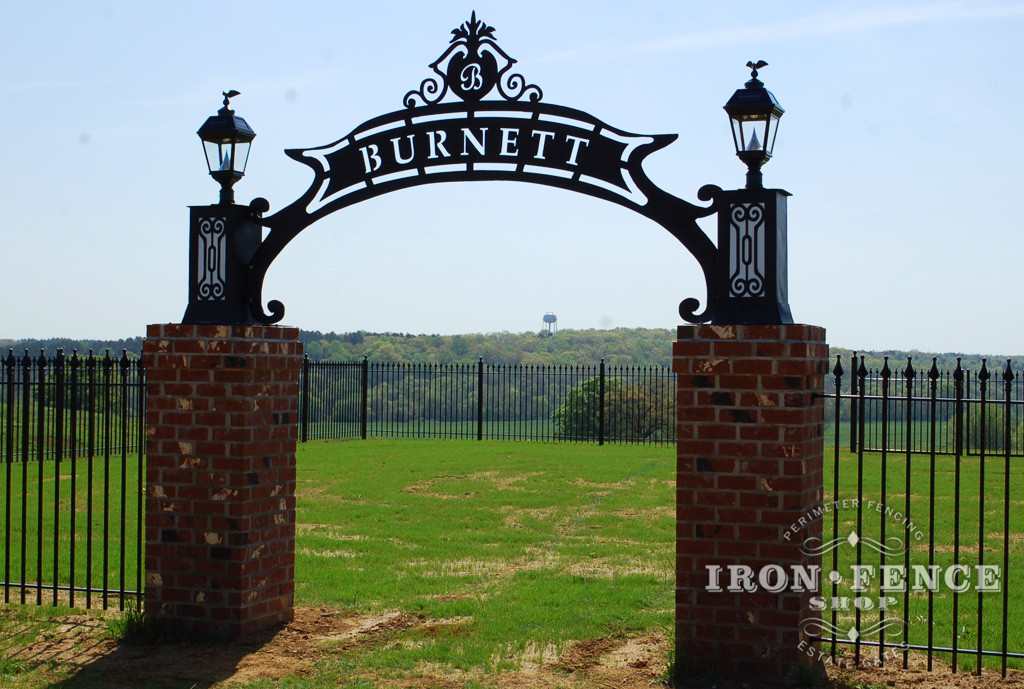 Wrought Iron Fence Surrounding a Family Cemetery with a Local Artist's Iron Sign and