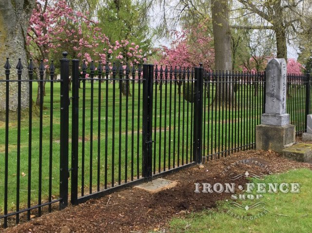 Wrought Iron Fence and Gate Surrounding a Cemetery