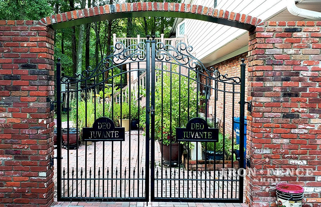 A Custom Wrought Iron Arched Gate with Lettering/ Motto Integrated