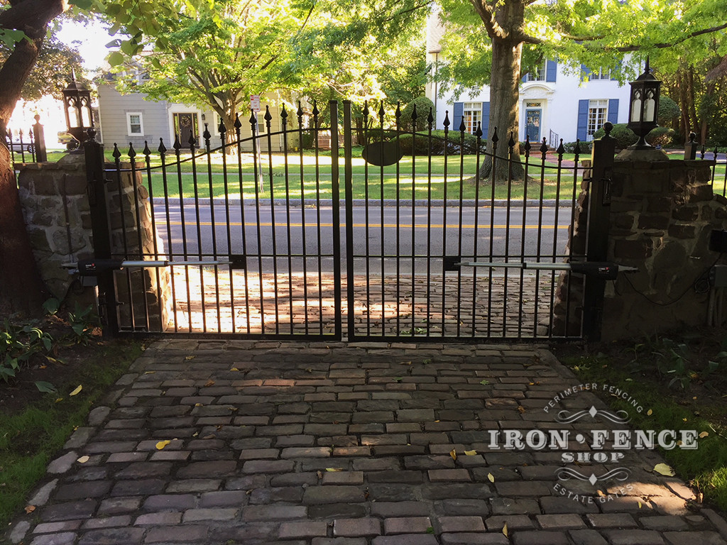 12ft Iron Driveway Gate with Automation Mounted on Posts  Behind Stone Columns