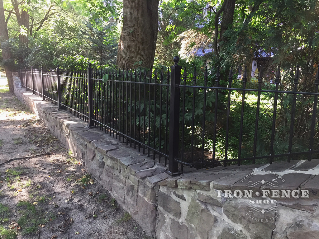 3ft Classic Iron Fence Installed on a Stone Wall Top with Flange Posts