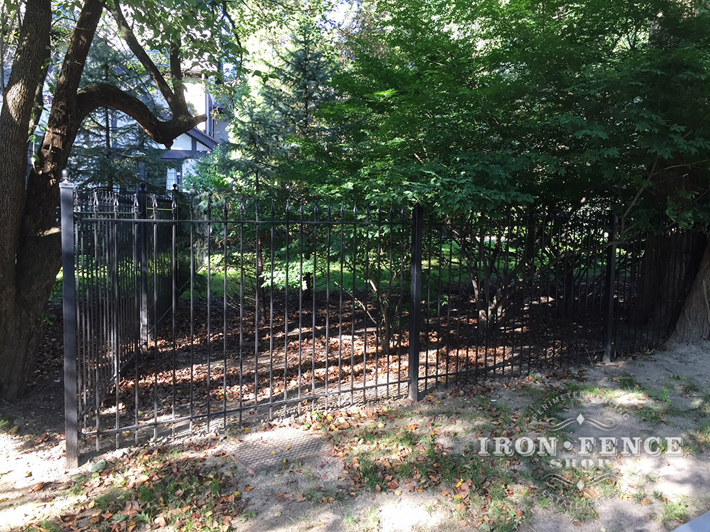 5ft Tall Classic Style Wrought Iron Fence Installed Around a Wooded Lot