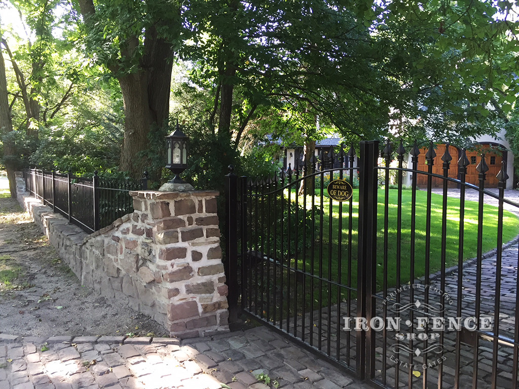 12ft Iron Driveway Gate Mounted on Posts  Behind Stone Columns