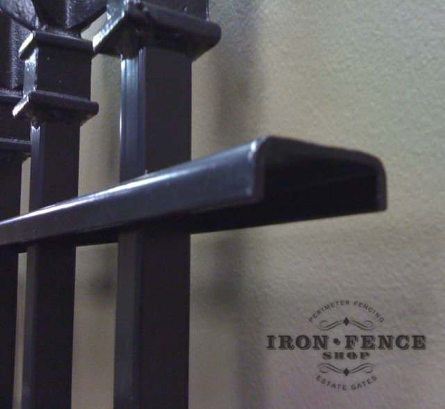 Side Shot of our Iron Fence Rail Showing the Picket Passing through the Punched Rail