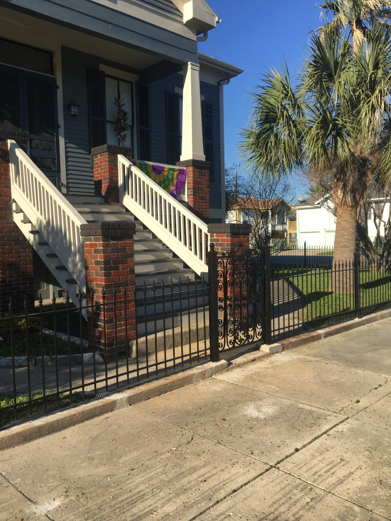 Updated Front Entryway with our Iron Fence and an Antique Iron Gate